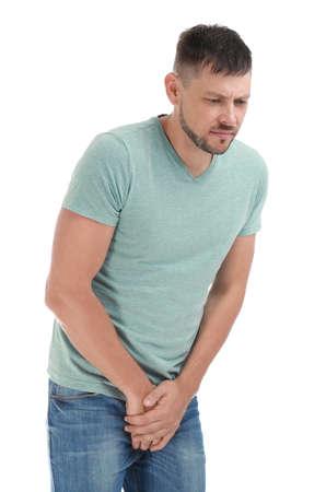 Man suffering from pain on white background. Urology problems Zdjęcie Seryjne