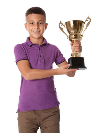 Happy boy with golden winning cup on white background Stockfoto