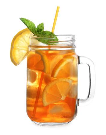 Mason jar of refreshing iced tea with lemon slices and mint on white background