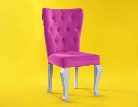 Stylish pink chair on yellow background. Element of interior design Stock fotó