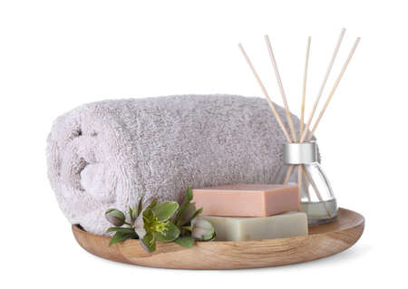 Tray with towel, air freshener and soap bars isolated on white. Spa treatment