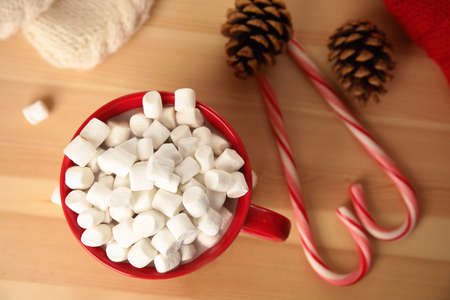 Cup of hot cocoa with marshmallows on wooden table, top view. Winter drink Stok Fotoğraf