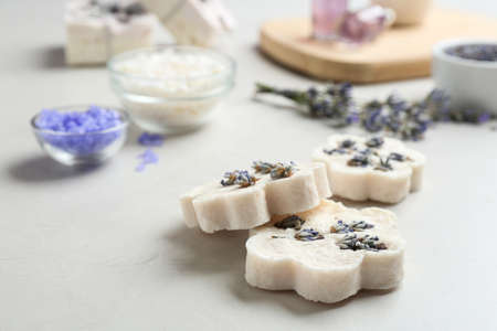 Hand made soap bars with lavender flowers on white table