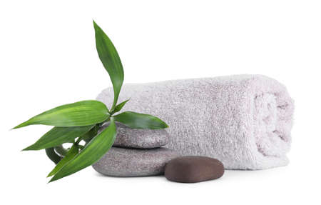 Towel, bamboo sprout and spa stones isolated on white
