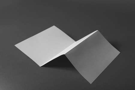 Blank brochure on dark grey background. Mock up for design