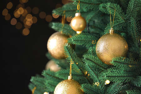 Beautiful Christmas tree with festive decor against blurred lights on background Standard-Bild - 130132646