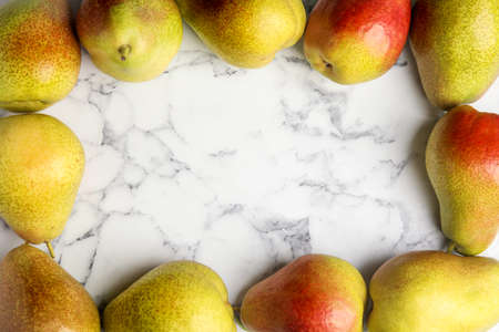 Ripe juicy pears on marble table, flat lay. Space for text