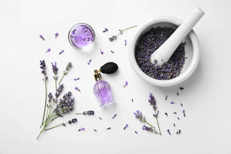 Composition with natural perfume and lavender flowers on white background, top view. Cosmetic product