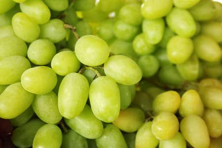Fresh ripe juicy white grapes as background, closeup view