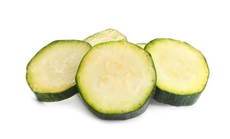 Slices of fresh ripe zucchini isolated on white