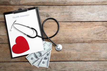 Flat lay composition with health insurance form and stethoscope on wooden background, space for text Stok Fotoğraf