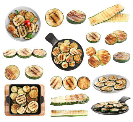 Set of delicious grilled and stuffed zucchinis on white background