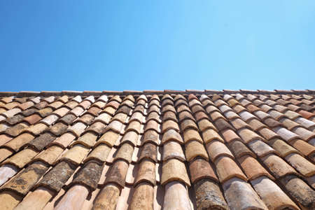 View of old roof tiles and blue sky on sunny day Stock fotó