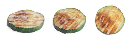 Set of delicious grilled zucchini slices on white background