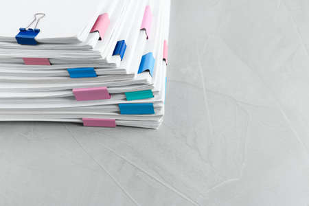 Stack of documents with binder clips on light table Stock Photo - 130133028