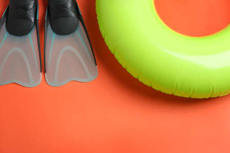 Flat lay composition with beach accessories on orange background, space for text Фото со стока