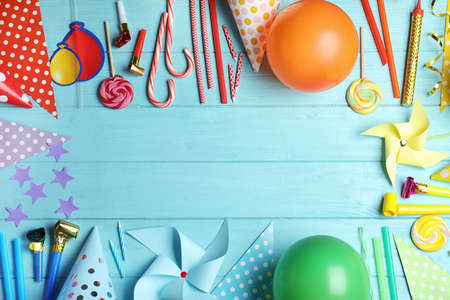 Colorful birthday accessories on blue wooden background, flat lay. Space for text 版權商用圖片