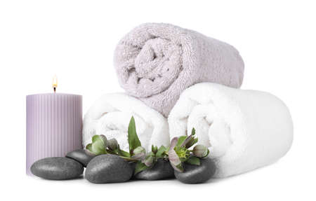 Composition with towels and spa stones isolated on white