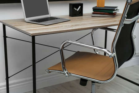 Stylish workplace interior with modern office chair Stock Photo - 130133186