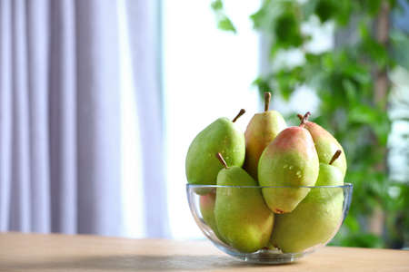 Fresh ripe pears on wooden table indoors. Space for text Stock fotó