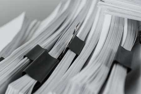 Pile of documents with binder clips, closeup Stock Photo