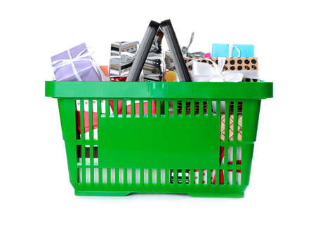 Green shopping basket with different gifts on white background