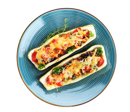 Plate of delicious stuffed zucchini on white background, top view