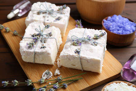 Hand made soap bars with lavender flowers on wooden board