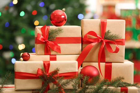 Many Christmas gifts on table against blurred background Фото со стока - 130133821