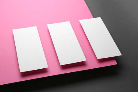 Empty sheets on color background. Mockup for design