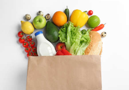 Paper bag with different groceries on white background, top view 스톡 콘텐츠
