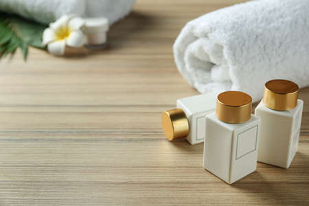 Composition with cosmetic products on wooden table, space for text. Spa therapy Imagens