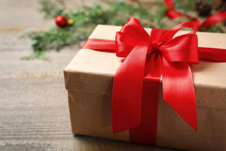 Christmas gift box on wooden background, closeup