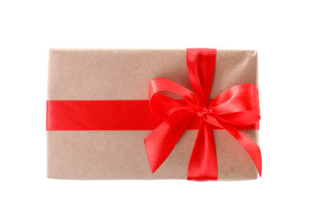 Christmas gift box decorated with ribbon bow on white background, top view Stock Photo - 130134060