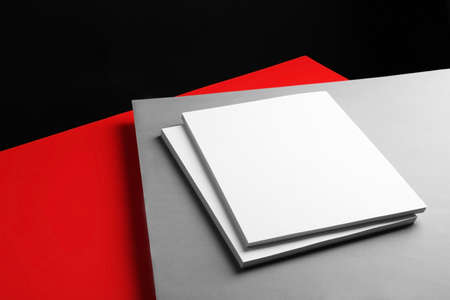 Empty stacks of papers on color background. Mockup for design Banco de Imagens - 130134066