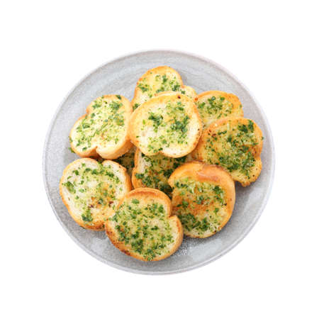 Slices of toasted bread with garlic and herbs on white background, top view Stock fotó