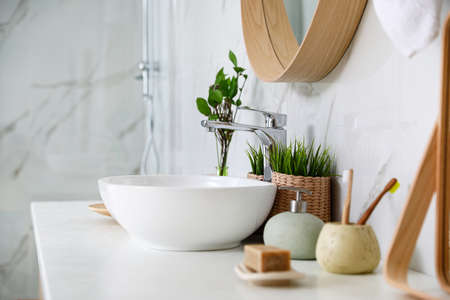 Modern bathroom interior with vessel sink and decor elements