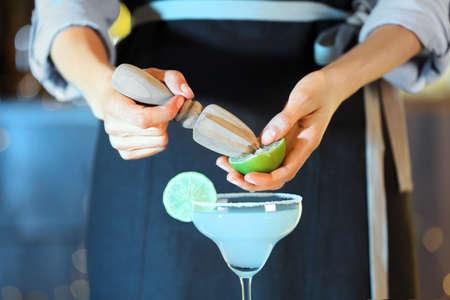 Bartender making fresh alcoholic cocktail, closeup view Stock Photo