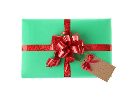 Christmas gift box decorated with ribbon bow on white background, top view Stock Photo - 130134280