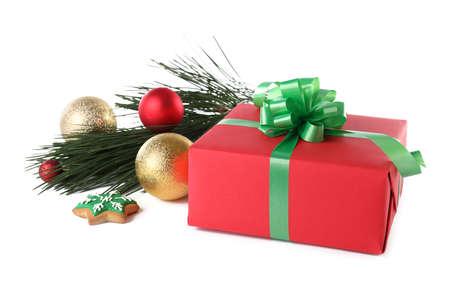 Christmas gift box with decoration on white background Standard-Bild - 130134407
