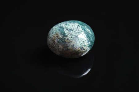 Beautiful moss agate gemstone on black background