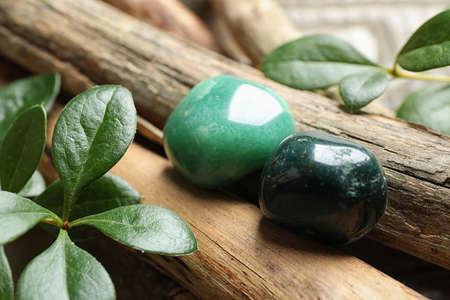 Beautiful green aventurin and heliotrope gemstones with wooden sticks Stock fotó