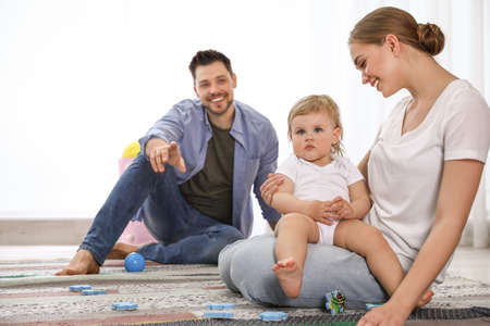 Parents spending time with their baby at home