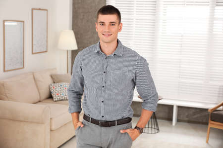 Portrait of handsome young young man in living room Stok Fotoğraf