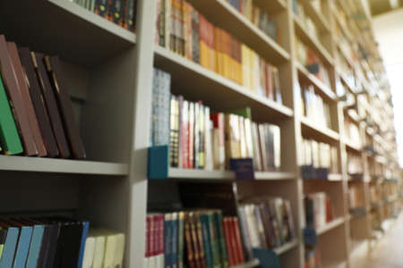 Blurred view of shelves with books in library