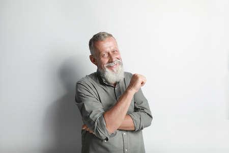 Portrait of handsome senior man on white background Stok Fotoğraf