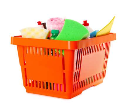Shopping basket full of detergents on white background