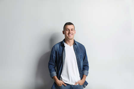 Portrait of handsome man on white background