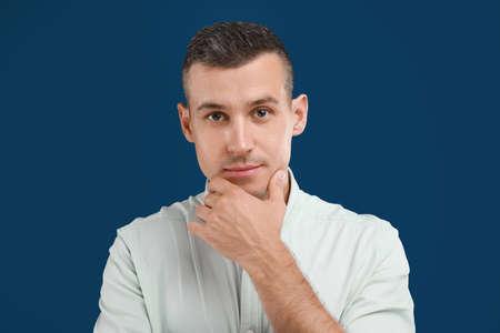 Portrait of handsome man on blue background