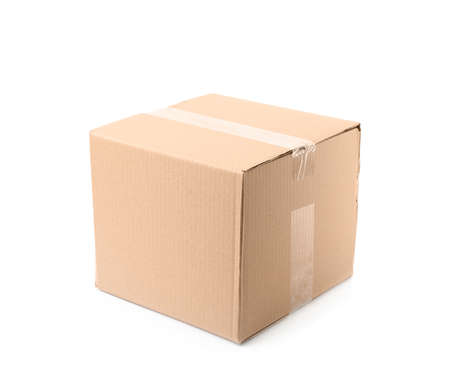 Closed cardboard box on white background. Mockup for design